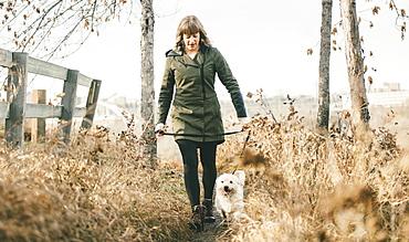 Woman walking her dog, Edmonton, Alberta, Canada