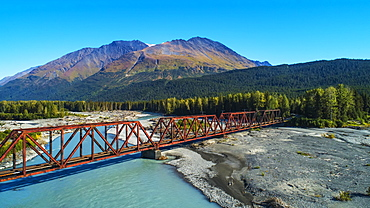 An aerial scenic of the Alaskan Railroad trestle crossing the Snow River on a sunny summer day in South-central Alaska, Alaska, United States of America
