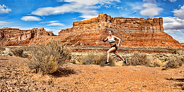 A woman running in the Valley of the Gods, stitched panorama composite, Utah, United States of America