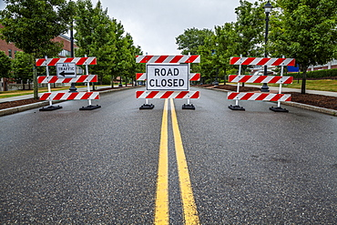 Double yellow line on a street with traffic barriers and 'Road Closed' sign, Connecticut, United States of America
