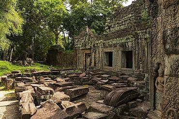 Temple courtyard littered with fallen stone blocks, Preah Khan, Angkor Wat, Siem Reap, Siem Reap Province, Cambodia