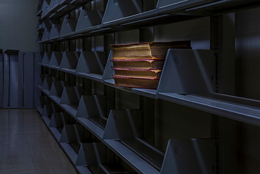 Old books on otherwise empty library bookshelves, Connecticut, United States of America