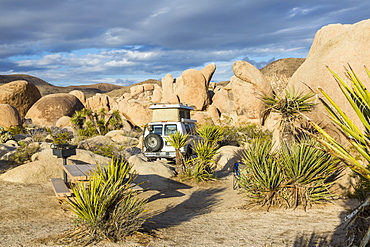 View of a campsite with a Sportsmobile Van in Joshua Tree National Park, California, United States of America