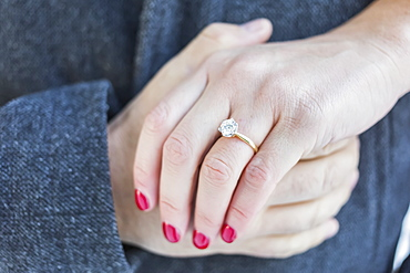 Diamond engagement ring with couple's hands clasped, Surrey, British Columbia, Canada