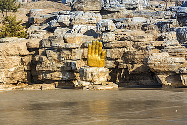 Buda hand along the frozen lake at Yungang Grottoes, ancient Chinese Buddhist temple grottoes near Datong, China