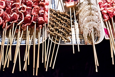 Street vendor with skeewers ready to be cooked, Beijing, China