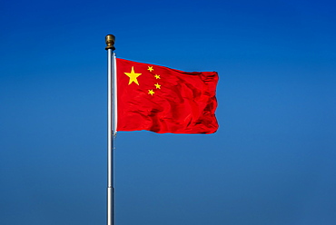 The flag of China, also known as the Five-star Red Flag, in Tiananmen Square, Beijing, China