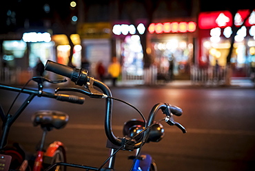 Bicycles and city lights, Beijing, China