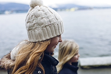 Two young girls walk on the seawall, Vancouver, British Columbia, Canada