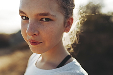Close-up portrait of a preteen girl with freckles, Los Angeles, California, United States of America