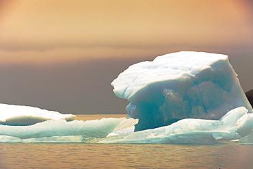 Close-up of a block of ice on a lake under a surreal light, Cafayate, Santa Cruz Province, Argentina