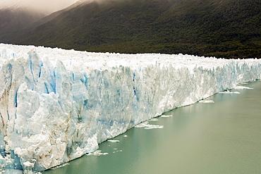 The Perito Moreno Glacier up close showing the blue ice and green water, Cafayate, Santa Cruz Province, Argentina