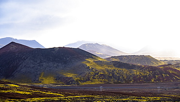 Small volcanos like these ones dot Iceland and the green moss that grows on the rich volcanic soil is iconic to Iceland, Grundarfjorour, Iceland
