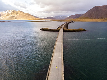 Man standing on bridge in Iceland. Image taken with a drone, Grundarfjorour, Iceland