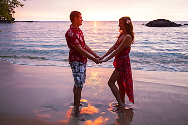 Honeymoon couple at Wailea Beach, Big Island Of Hawaii, Island of Hawaii, Hawaii, United States of America