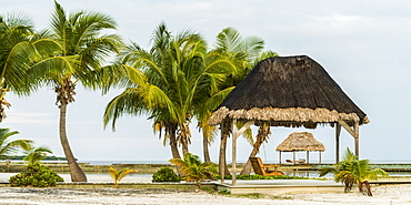 Thatch shelter on a Caribbean beach, Belize