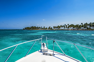 Vibrant turquoise ocean and the bow of a boat, Belize