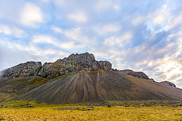A rugged rocky mountain landscape at sunset in the summer, Iceland