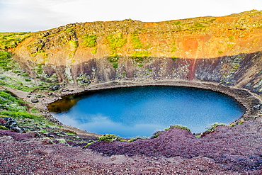 The Kerid Volcano Crater is a popular tourist attraction on the Golden Circle route in Western Iceland, Iceland