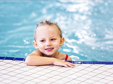 Young Girl Swimming On Her Own In An Indoor Swimming Pool, Spruce Grove, Alberta, Canada