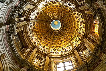 View of a cathedral dome with stained glass windows from directly below, Siena, Tuscany, Italy