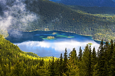Alpine lake viewed from above and framed with tree covered mountain slopes, Grainau, Bavaria, Germany