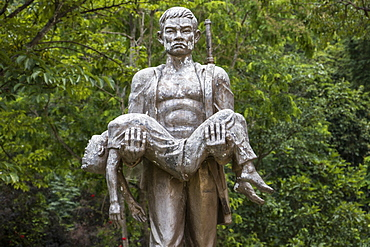 Memorial statue by Tham Piu Cave, place where on 24 November 1969, a single rocket fired from a US aircraft killed an estimated 374 people who had taken refuge in the cave, Xiangkhouang, Laos