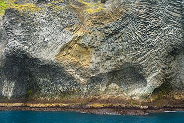 Strange basalt rock formations on Heimaey, the largest of the Westman Islands, Iceland