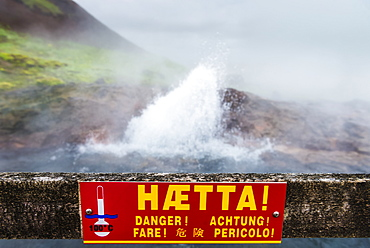 Warning sign in front of Europe's largest hot water spring, Kleppjarnsreykir, Iceland