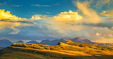 Sunlight illuminating the mountainous landscape and clouds, Isle of Skye, Scotland