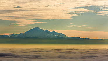 The peak of Mount Baker viewed from above the clouds, Vancouver, British Columbia, Canada