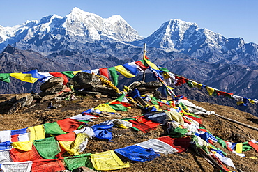 Buddhist prayer flags at the summit of Pikey Peak in the Himalayas, Nepal