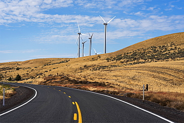 Wind turbines are found along a road in Gilliam County, Arlington, Oregon, United States of America
