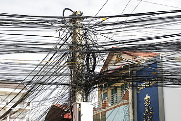 Lamppost with numerous wires and cables, Phnom Penh, Cambodia