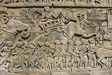 Bas-relief battle scene between the Khmer and Cham armies with Elephants on the Eastern gallery of the Bayon, Angkor Thom, Siem Reap, Cambodia