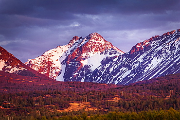 Sunset glows on Ptarmigan Peak in Chugach Mountains, South-central Alaska in spring, Alaska, United States of America