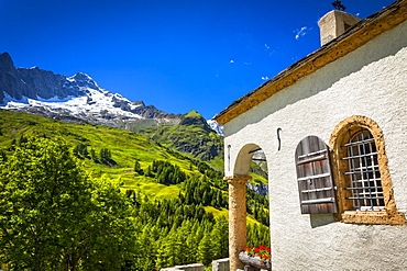 A small chapel at Ferret under blue sky, Ferret, Val Ferret, Switzerland