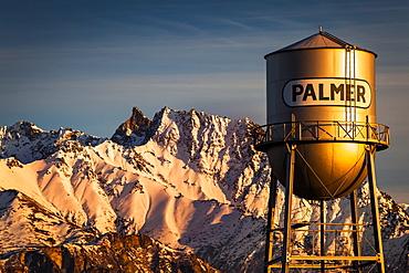Palmer water tower and Matanuska Peak at sunset in winter, Matanuska Valley, South-central, Palmer, Alaska, United States of America