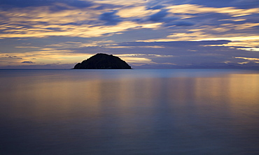 Beautiful sunrise reflected in the tranquil waters of the Pacific Ocean, Abel Tasman National Park, Nelson, New Zealand