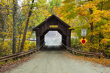 A covered bridge on a back country road in autumn, Green Mountains, Stowe, Vermont, United States of America