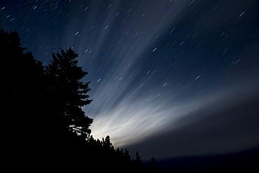 Light streaming through the night sky, The Ovens Natural Park, Nova Scotia, Canada