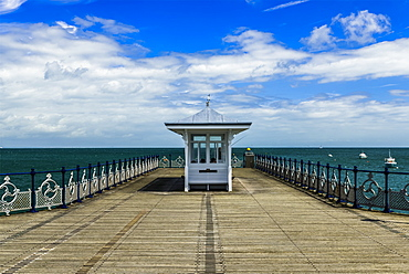 Pier with ornate railing and a view of the ocean and horizon, Swanage, Dorset, England