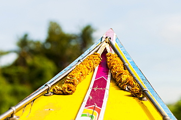 The front of a traditional Thai boat on the way to one of Bangkok's markets, Bangkok, Thailand