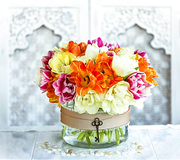 Bouquet of colourful flowers in a decorative container