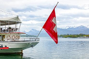 Tour boat with flag of Switzerland on Lake Lucerne, Lucerne, Lucerne, Switzerland