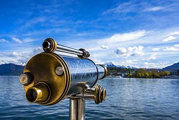 Binoculars looking out to water of Lake Lucerne and shoreline, Lucerne, Lucerne, Switzerland