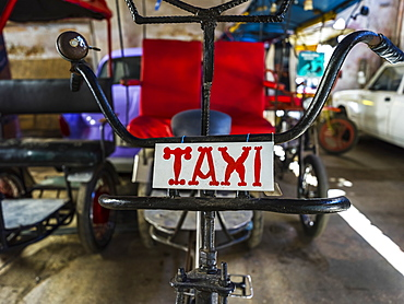 Cycle rickshaw with taxi sign, Havana, Cuba