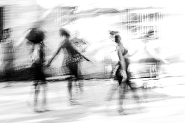 Black and white image of Cuban dance with dancers blurred in motion, Havana, Cuba