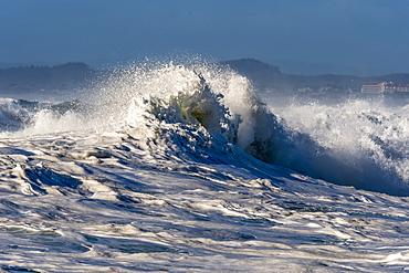 A wave breaks at Seaside Cove, Seaside, Oregon, United States of America