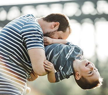 Father plays with his young son, Edmonton, Alberta, Canada